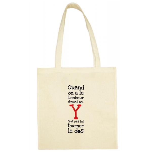 """Tote bag """"quand on a le bonheur devant soi, y faut pas lui tourner le dos"""" couleur blanc"""