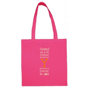 """Tote bag """"quand on a le bonheur devant soi, y faut pas lui tourner le dos"""" couleur fushia"""