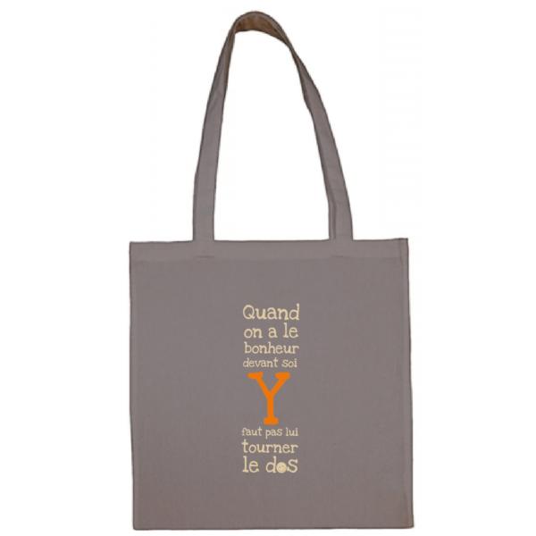"""Tote bag """"quand on a le bonheur devant soi, y faut pas lui tourner le dos"""" couleur gris"""