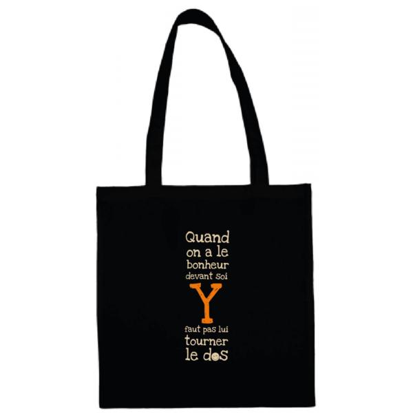 """Tote bag """"quand on a le bonheur devant soi, y faut pas lui tourner le dos"""" couleur noir"""